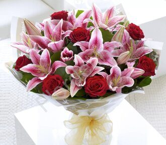 Stargazer lily and red roses bouquet