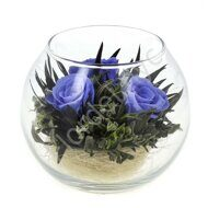 Preserved blue roses in vase