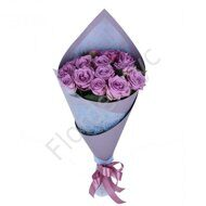 Purple roses wrapped in paper