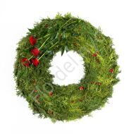 Funeral wreath with red roses and thuja