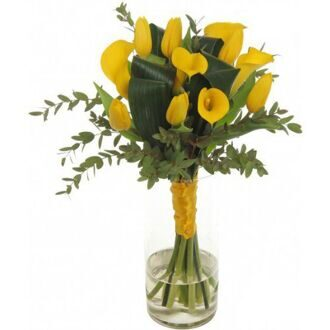 Bouquet of yellow tulips and callas