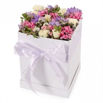 Box with shrub roses and freesia