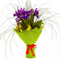 Bouquet of irises and tulips in greenery
