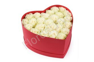 White preserved roses in heart shaped box
