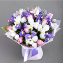 White and blue irises with tulips