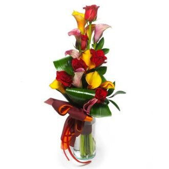 Bouquet of roses and colorful callas
