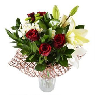 Bouquet of red roses and white lilies