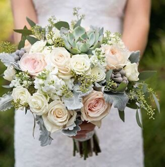 Bridal bouquet with roses and succulents