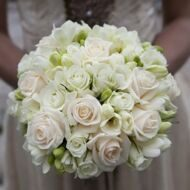 White bridal bouquet with roses and freesia