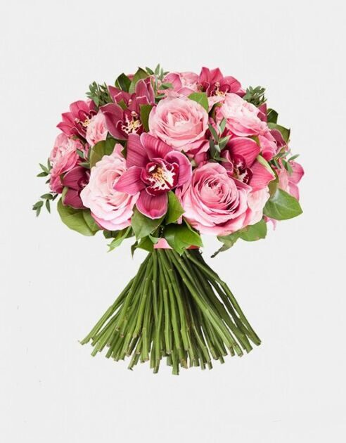 Bouquet of flowers of orchid and pink roses
