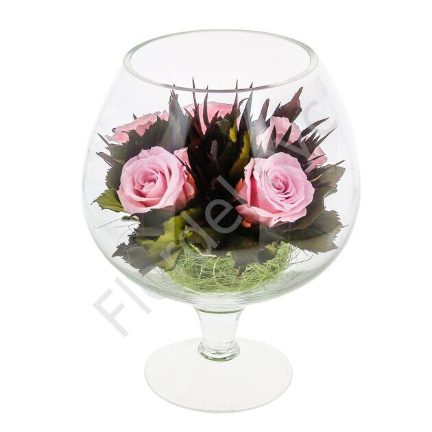 Preserved roses in a glass vase