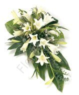 Funeral arrangement with lilies and eucalyptus